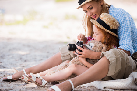 europeans: mother and daughter with camera