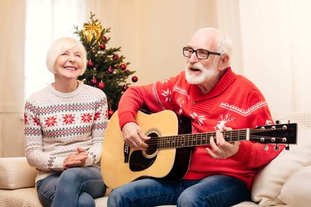 senior man singing and playing on guitar Stock Photo