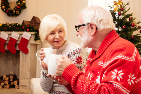 christmastime: senior couple with cacao