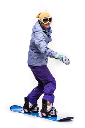 woman standing on snowboard