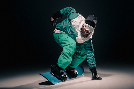 snowboarder practicing on snowboard Stock Photo