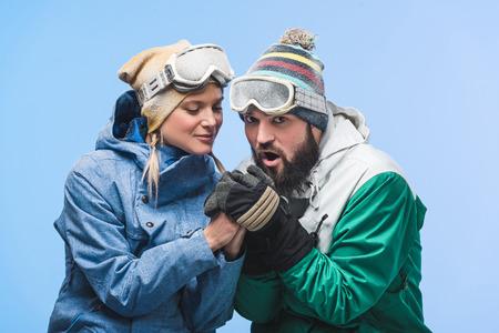 man warming girlfriends hands