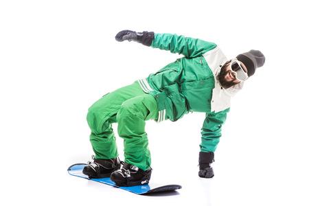 man sliding on snowboard