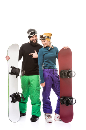 couple with snowboarders Banco de Imagens