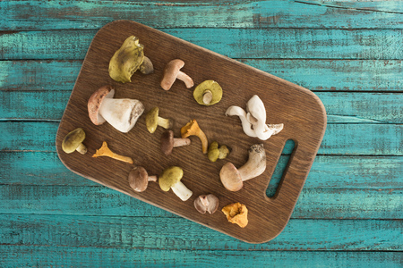 Different types of mushrooms on cutting board Stock fotó - 88746992