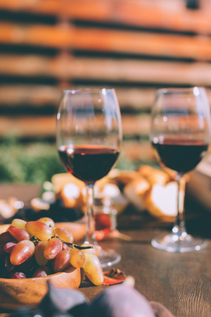 red wine and bowl of grapes Stock Photo