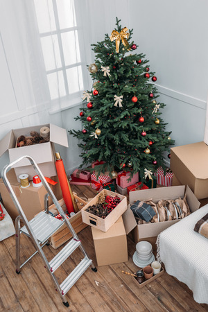 christmas tree with messy boxes on floor Stock Photo