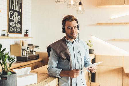 barista in headphones with tablet