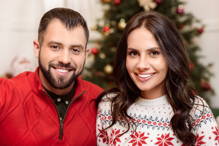 christmastime: happy couple at christmastime Stock Photo