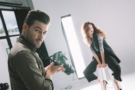 photographer and model on fashion shoot 版權商用圖片