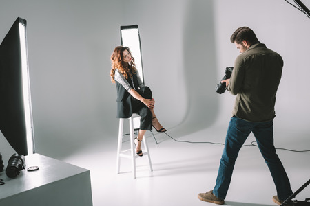 photographer and beautiful model Stock Photo