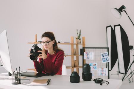 photographer with lenses, digital camera