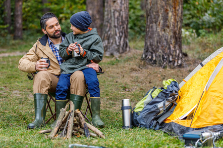 father and son in camping with tent Stock Photo