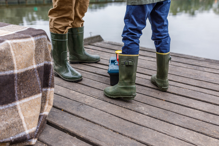 father and son in rubber boots Reklamní fotografie
