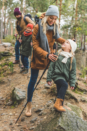 family walking in autumn forest 스톡 콘텐츠