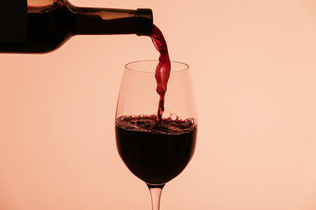 red wine pouring into glass Banco de Imagens