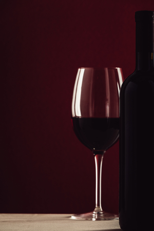 wineglass and bottle of red wine