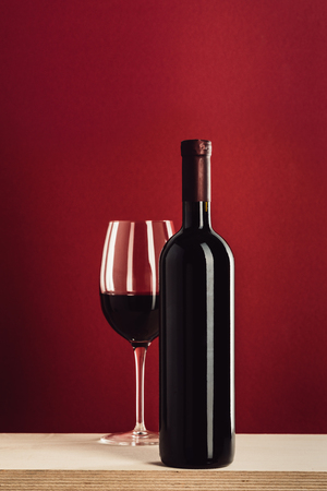 glass and bottle of red wine Banco de Imagens