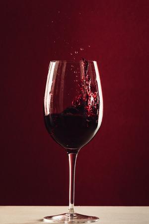 splash of wine in wineglass