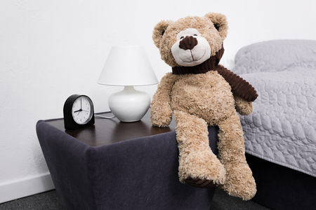 teddy bear on nightstand Stock Photo