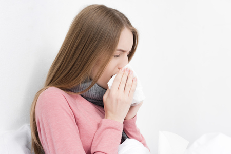 girl wiping nose