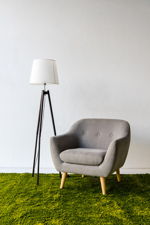 Gray armchair and lamp