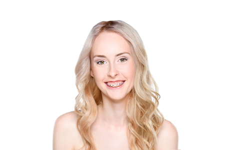 Woman with braces smiling cheerfully Фото со стока
