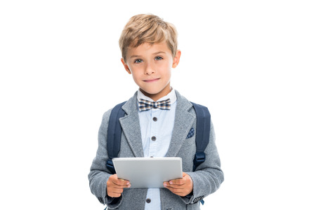 smiling schoolboy with digital tablet Imagens