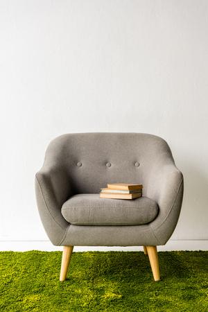 books on gray armchair