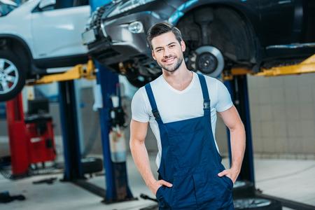 Smiling young automechanic Stock Photo