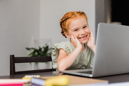 happy little girl with laptop