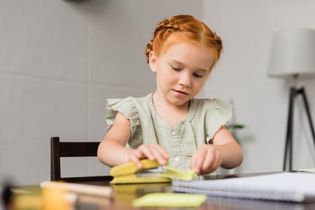 little girl with stapler