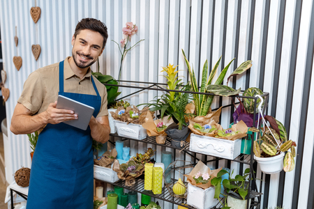 florist with digital tablet