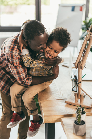 african-american father and son hugging Stock Photo