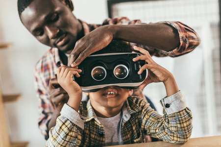 father and son with vr headset