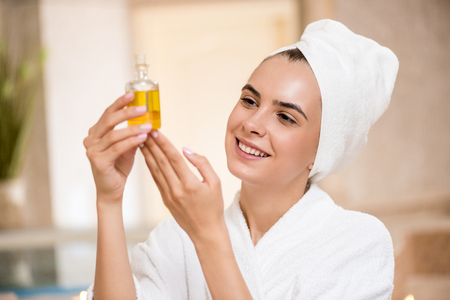 woman with body oil
