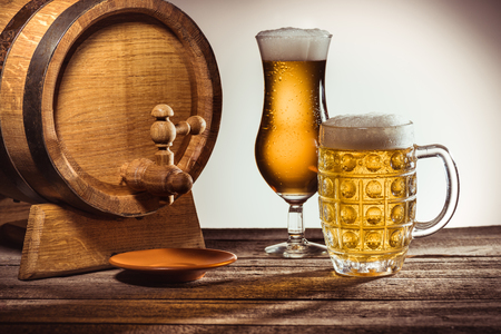 barrel and beer in glasses on wooden tabletop with wheat ears Stock fotó