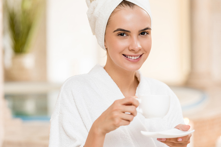 woman drinking tea after spa Stock Photo