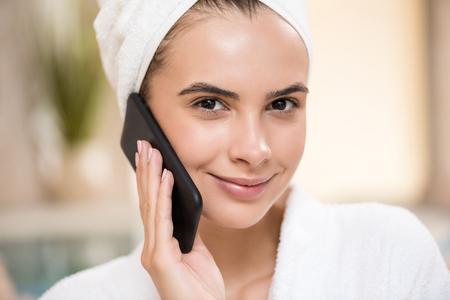 woman bath: woman using smartphone