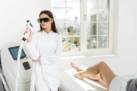 attractive young hair removal therapist