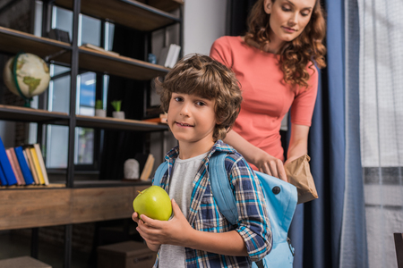 mother packing son before school Stok Fotoğraf - 89782826