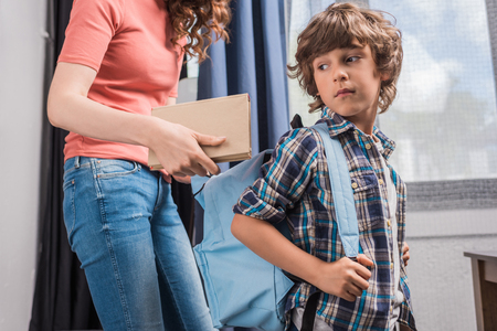 mother packing son before school Stok Fotoğraf - 89782864