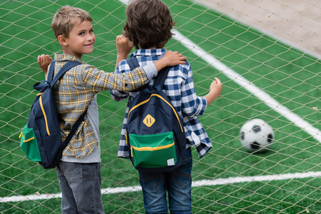 schoolboys on soccer field Stock Photo