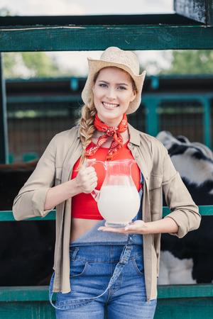farmer with milk in glass jug Stock Photo