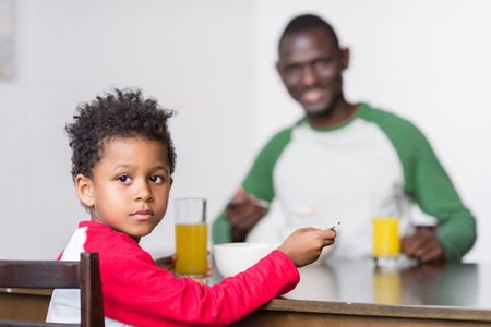 father and son eating breakfast Stock Photo - 89867052