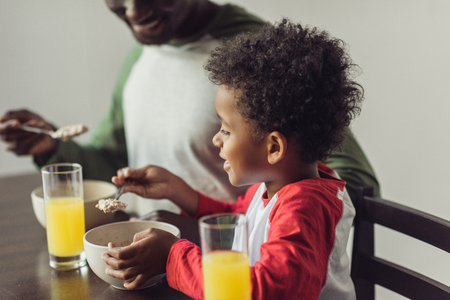 father and son eating breakfast Stock Photo - 89867061