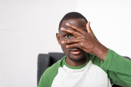 man covering face with hand Banco de Imagens