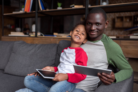 father and son using tablets Stock Photo