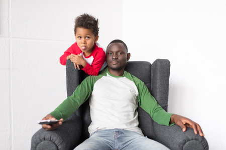 father and son watching tv Stock Photo - 89865186
