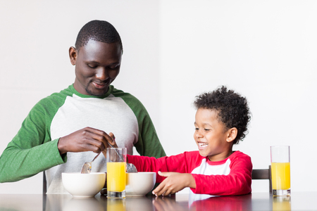 father and son eating breakfast Stock Photo - 89865339